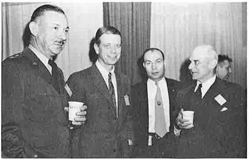 Furney, Keirn, McCormack, and Doolittle during a coffee break in briefing session