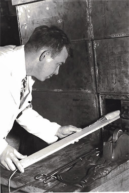 Elmer Rylander inserting corn tassels into the thermal column of CP-3