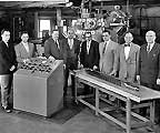 An EBWR fuel assembly in the fabrication shop with members of the fabrication group